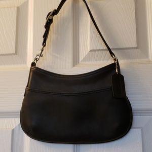 Coach small purse never used black leather